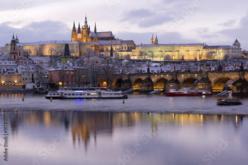Evening colorful snowy Christmas Prague Lesser Town with gothic Castle and Charles Bridge, Czech republic - 187813857