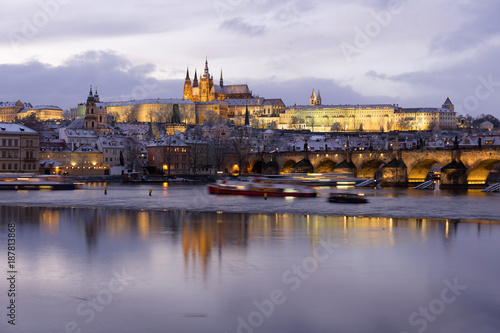 Poster Evening colorful snowy Christmas Prague Lesser Town with gothic Castle and Charles Bridge, Czech republic