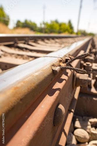In de dag Spoorlijn Old rusty metal sleepers on the railway