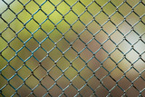 Metal mesh on the fence as a background - 187842689