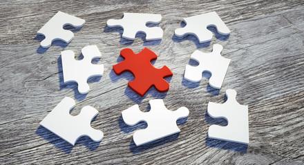 Puzzle-Teile in Weiß und Rot auf Holz