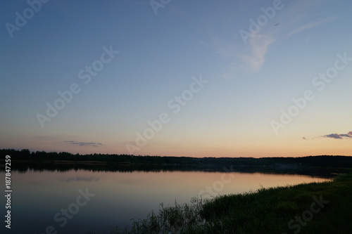 Foto Murales sunset over a lake in forest