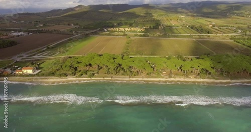 Aerial, beautiful sea shore and fields and hills on the background