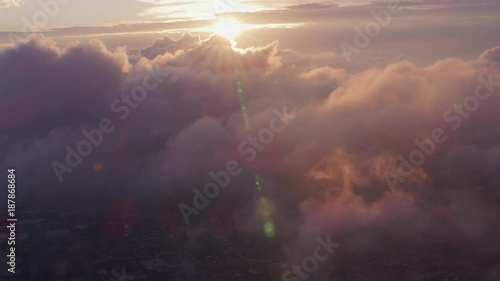 New York City circa-2017, Aerial view of sunrise over clouds with Manhattan below. Shot with Cineflex and RED Epic-W Helium.