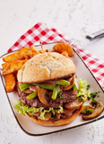 Meat burger with salad, mushrooms, fried potatoes - 187877287