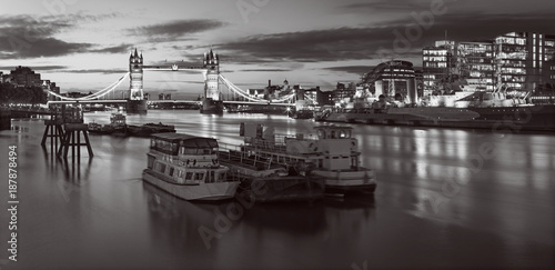 London - The Tower bridge and riverside in morning dusk with the dramatic clouds. - 187878494