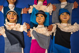Otavalo, Ecuador- November 25, 2017: closeup of indigenous dolls sold in the Saturday artisan market - 187880287