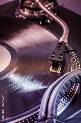 Dj mixer with headphones at nightclub. Musical instrument - 187880279