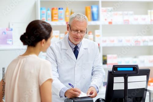 Fotobehang Apotheek senior apothecary with prescription at pharmacy