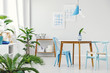 Blue dining room with plants