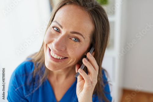 woman calling on smartphone at office or home
