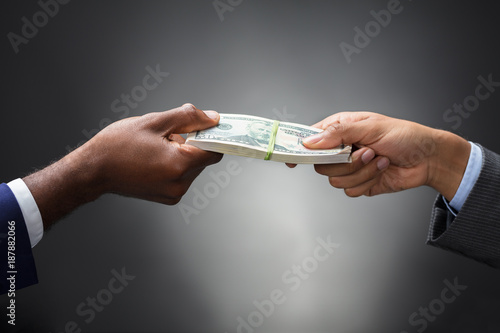 Person Giving Bundle Of Banknote - 187882066