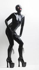 standing woman wearing latex clothes