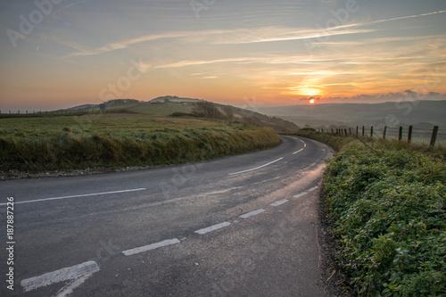Keuken foto achterwand Beige road over hills at sunrise
