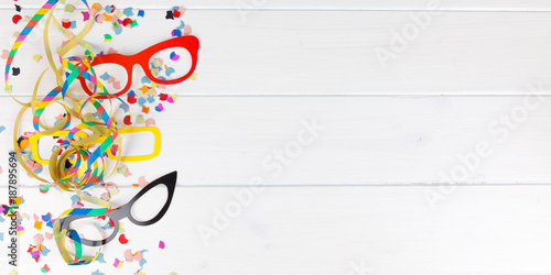 Foto Murales carnival party background with confetti, streamer and glasses