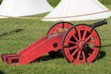 Antique Medieval Red Metallic Cannon on Wheels - 187896078