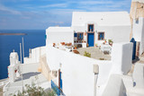 Santorini - The typically little house and yard with he flowers in Oia. - 187896467