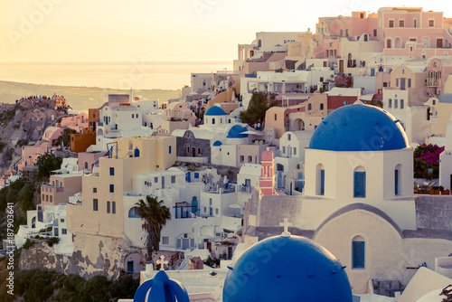 Aluminium Santorini Oia, Santorini - Greece. cityscape of oia, traditional greek village of Santorini, with blue domes of Churches at Sunset.