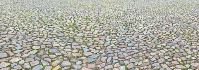 Schönes antikes Kopfsteinpflaster im Panoformat