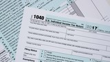 Slow rotation of macro close up of 2017 IRS form 1040 - 187913259