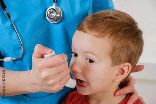 Foto Murales Respiratory system illness, sad child with inhaler