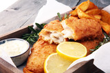 traditional British fish and chips with potato and lemon - 187928410