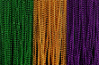 Green, gold, and purple Mardi Gras beads background