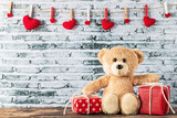 Fototapeta Child room - Teddy bear sitting with gift box © aireo