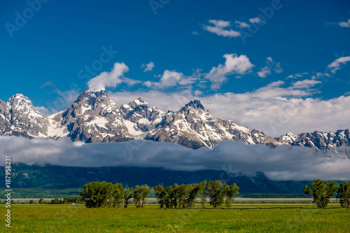 Foto op Canvas Natuur Grand Teton Mountains with low clouds