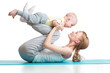 Leinwanddruck Bild - young mother does fitness exercises together with baby boy isolated