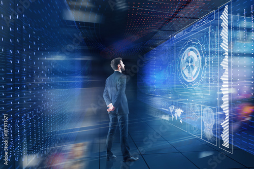 Businessman looking at digital projection