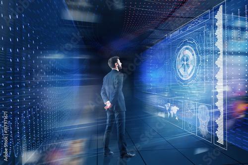 Foto Murales Businessman looking at digital projection