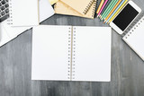 Office desktop with empty notepad