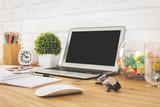 Creative designer desk top with blank laptop