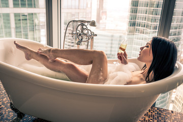 Seductive woman taking relaxing bath