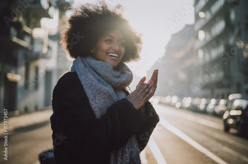 Foto op Aluminium Kasteel Beautiful girl with afro haircut walking on the street