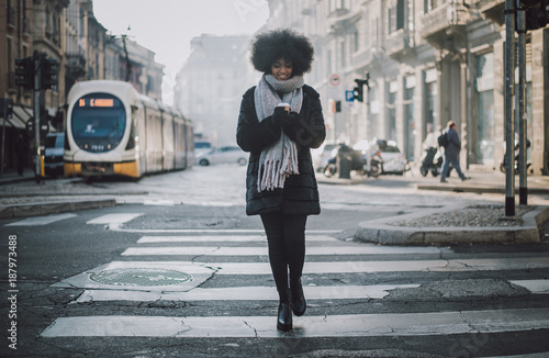 Fridge magnet Beautiful girl with afro haircut walking on the street
