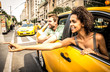 Happy couple on a yellow cab in New york - 187974094