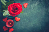 Valentines day greeting card concept. Red rose and candle on  blue background - 187976455