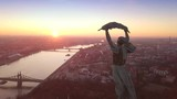 Budapest, Hungary - 4K aerial drone footage at sunrise of drone flying around of Statue of Liberty at Citadella - 187977087