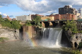 Fototapety High Falls at Rochester, New York. Rainbow at base of the falls and city skyline in autumn
