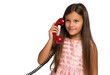 Child on a red vintage phone