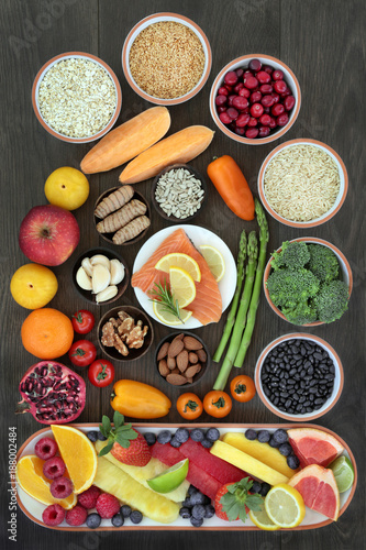 Health food for heart fitness concept with superfoods of fish fruit, vegetables, seeds, nuts, grains, cereals, spice and herbs providing high levels of omega 3 fatty acids, vitamins, and antioxidants. © marilyn barbone