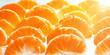 slices of tangerine on white background