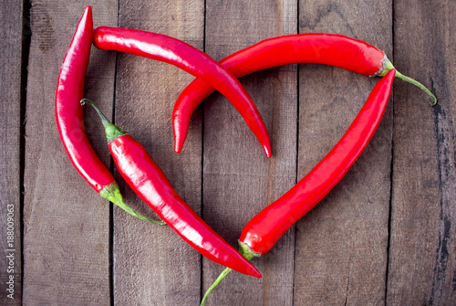 Foto op Canvas Hot chili peppers hot peppers laid out in the shape of a heart