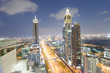DUBAI, UAE - DECEMBER 11, 2016: Downrtown skyline along Sheikh Zayed Road at night as seen from rooftop. The city attracts 30 million tourists annually