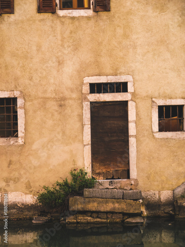 Foto Murales Old Wooden Door with reflection in the water