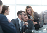 employees discussing financial charts - 188020242