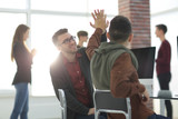 business colleagues giving each other high five - 188020405