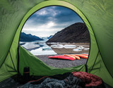 Camp by glacial lake in the mountains with kayak, Iceland - 188030287